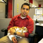 Product Manager Jesus Sanchez takes a break to meet System ID's Easter bunny, Ginger.