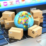 Shipping, delivery and logistic concept. Earth and cardboard boxes on laptop keyboard. Online technology. 3d