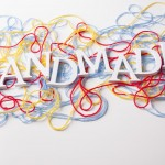 Word Handmade and colorful yarn background