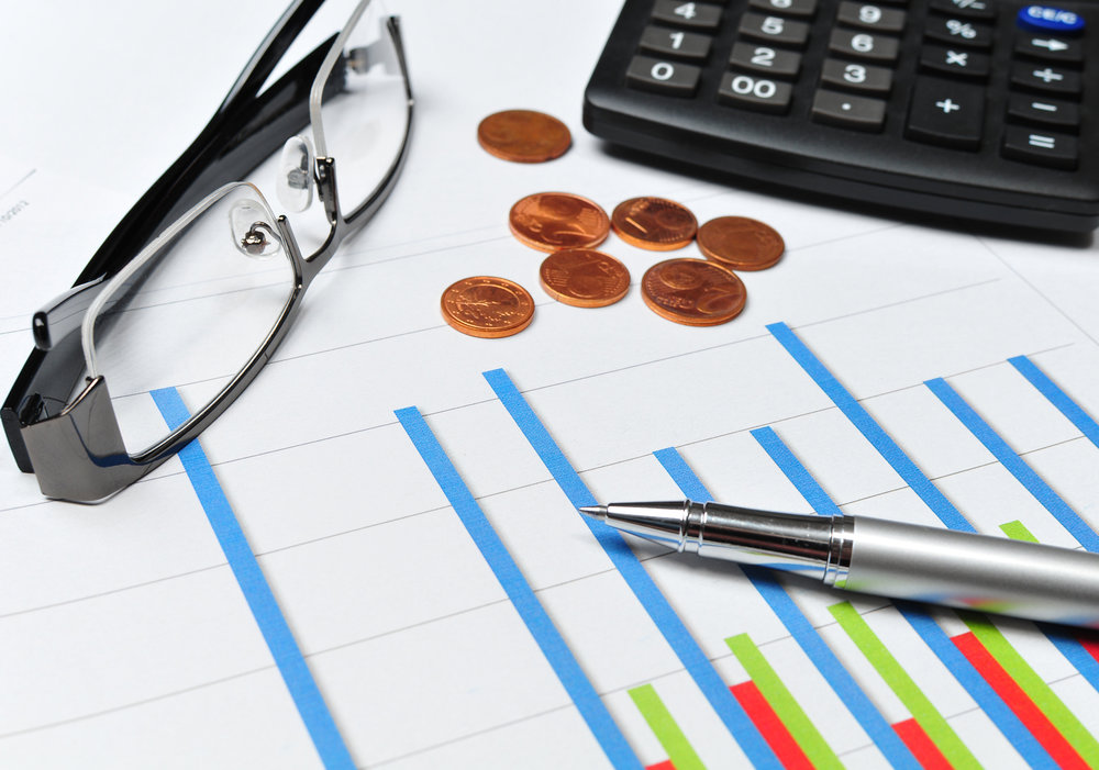 business chart with calculator and euro coins
