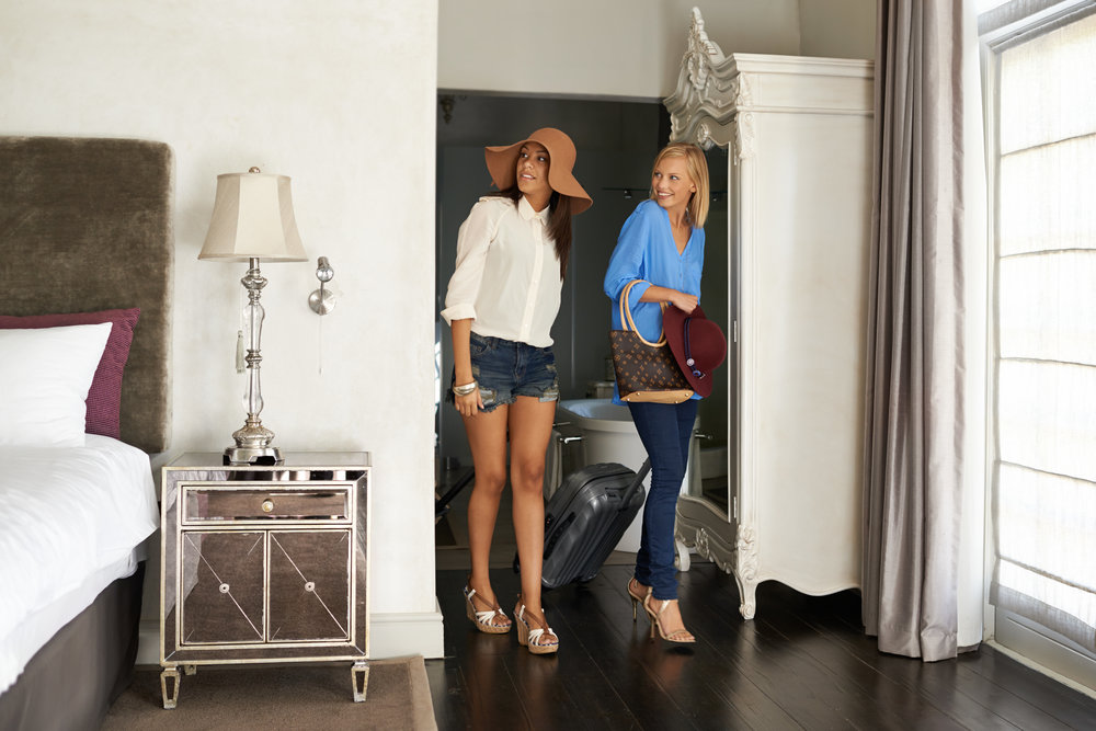 Shot of two young women arriving to their holiday room