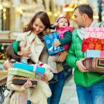 Family buying Christmas gifts in a shopping mall
