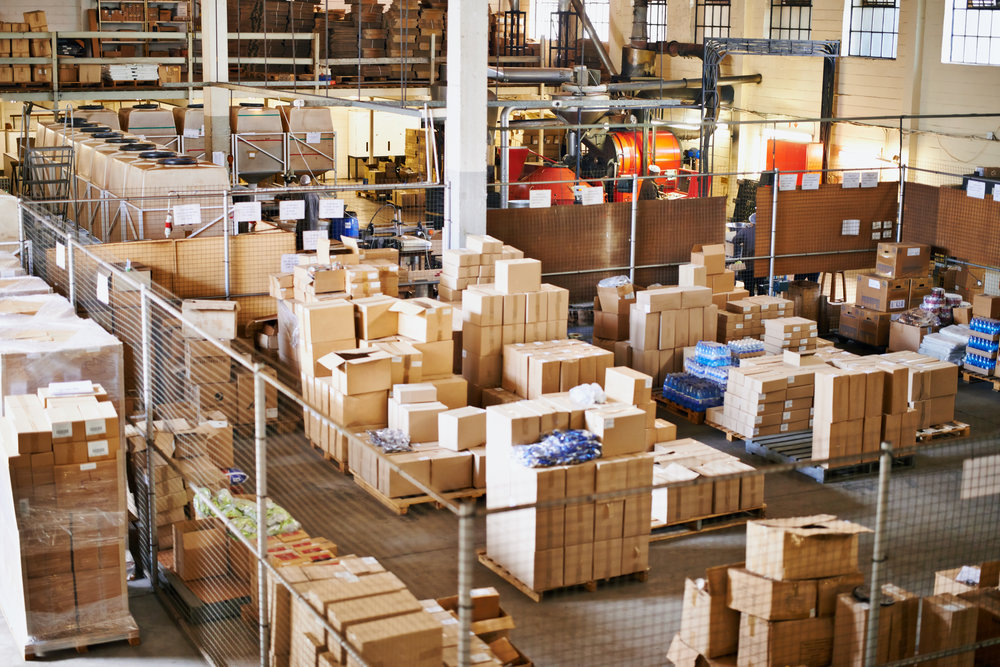 Shot of the interior of a large packaging and distribution warehouse